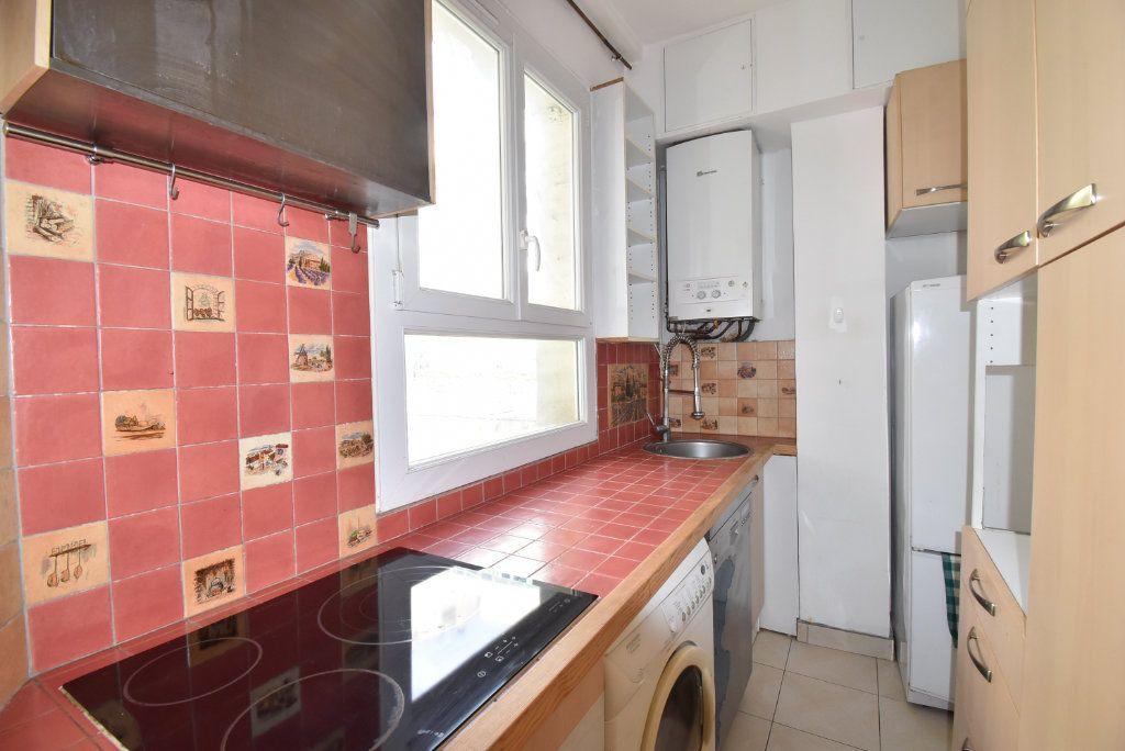 Appartement à louer 3 66.97m2 à Paris 17 vignette-5