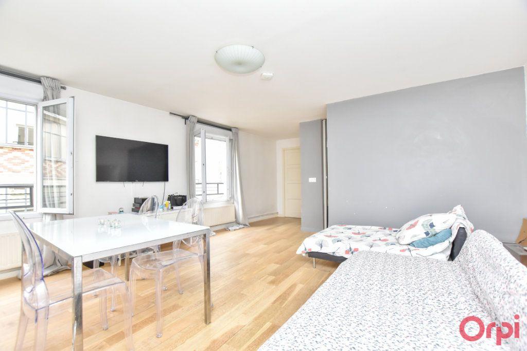 Appartement à vendre 3 55.04m2 à Paris 10 vignette-1