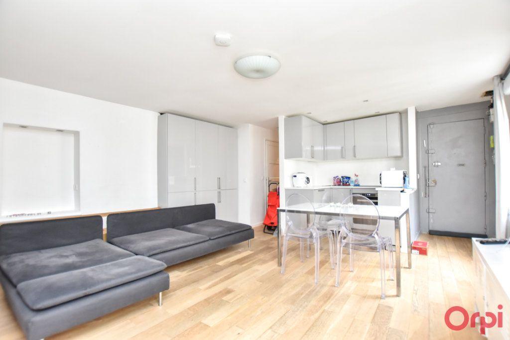 Appartement à vendre 3 55.04m2 à Paris 10 vignette-2