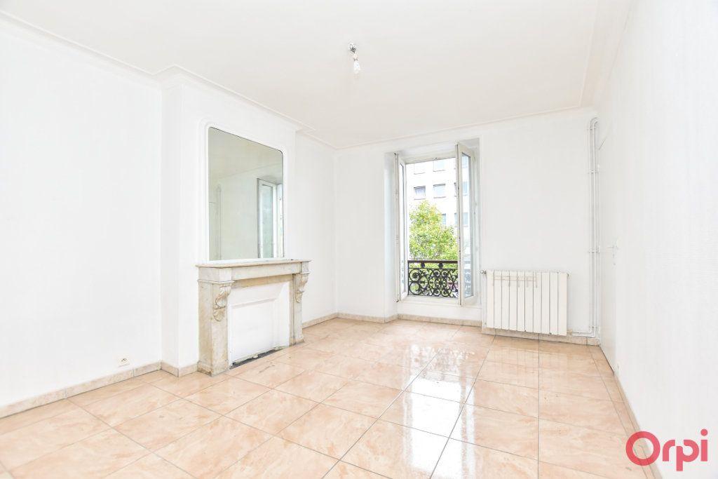 Appartement à vendre 3 61.19m2 à Paris 10 vignette-2