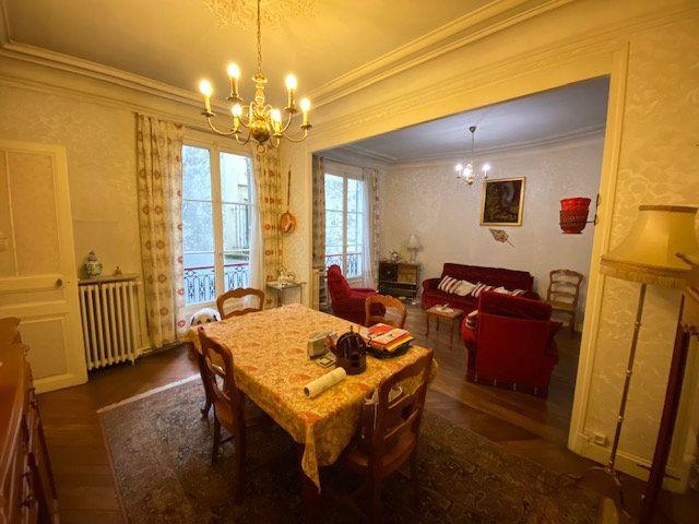 Appartement à vendre 3 60.52m2 à Paris 10 vignette-1