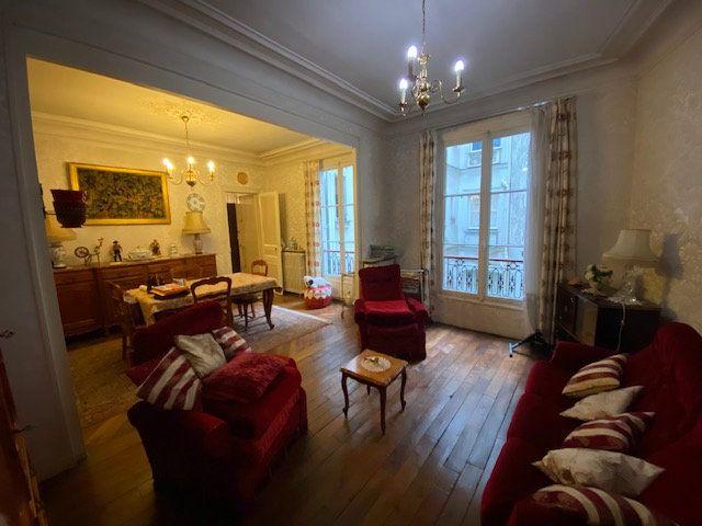 Appartement à vendre 3 60.52m2 à Paris 10 vignette-2