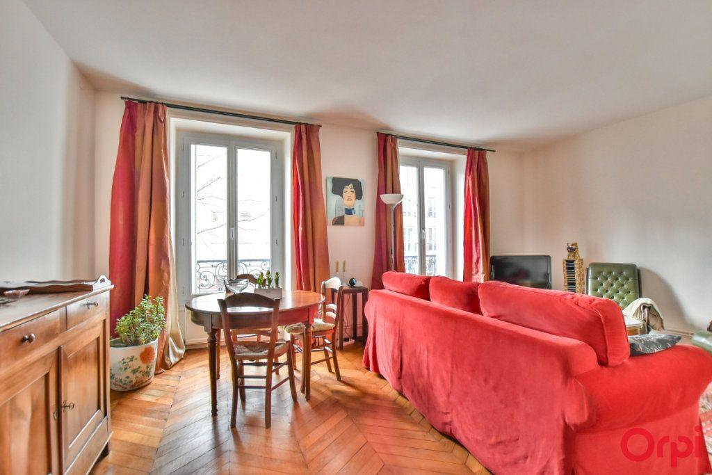 Appartement à vendre 3 72m2 à Paris 18 vignette-2