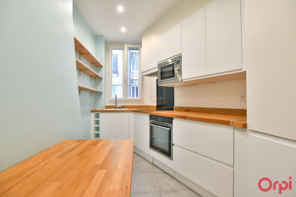 Appartement à vendre 3 69m2 à Paris 18 vignette-5
