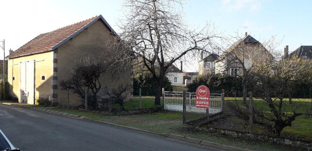 Terrain à vendre 0 916m2 à Saint-Cosme-en-Vairais vignette-1