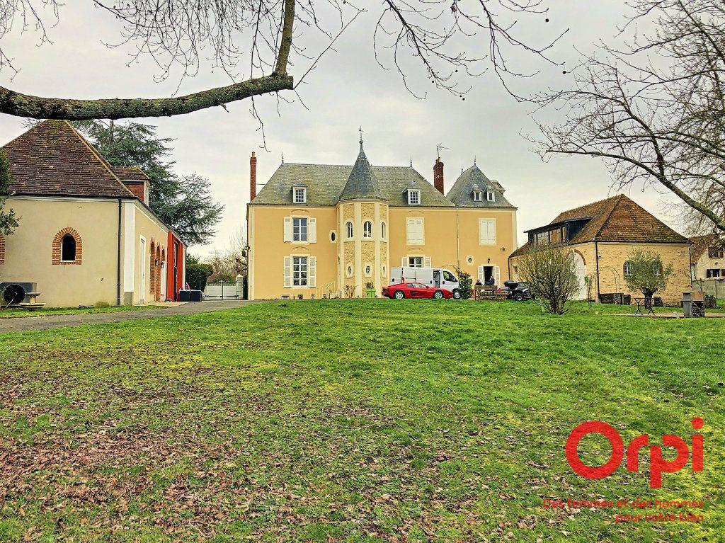 Maison à vendre 12 500m2 à Sceaux-sur-Huisne vignette-1